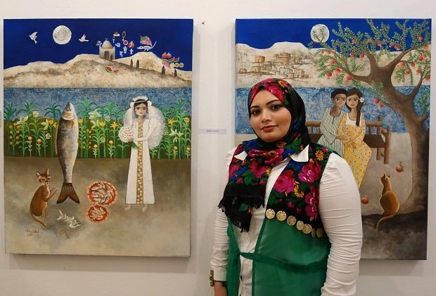 Heba Sayed with two of her artworks