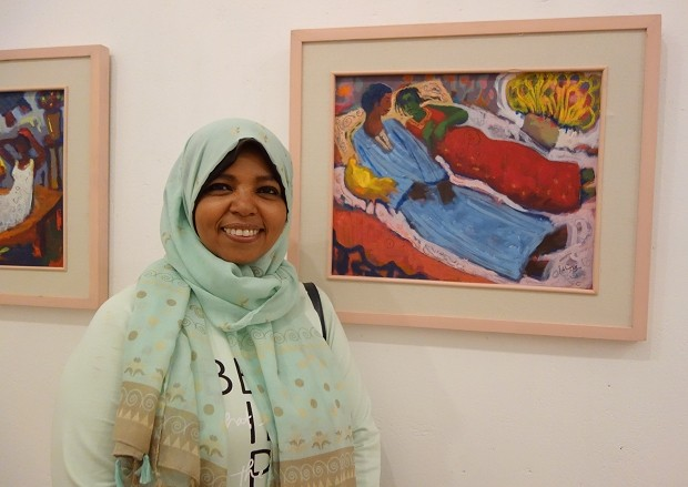 Mervat Shazly with one of her artworks