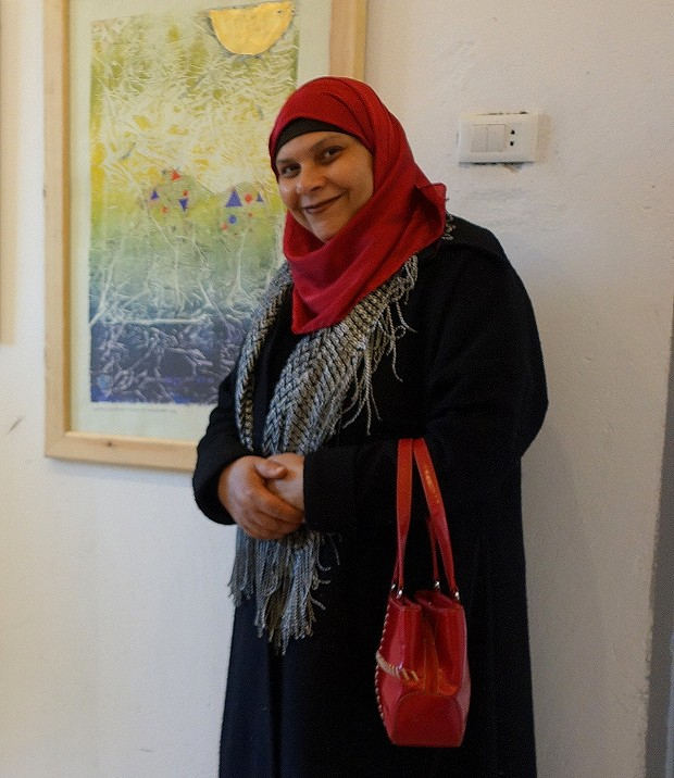 Wafa Abdel Maqsoud with one of her artworks
