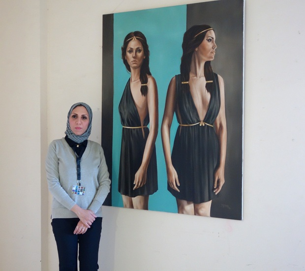 Yousra Hafad with one of her artworks